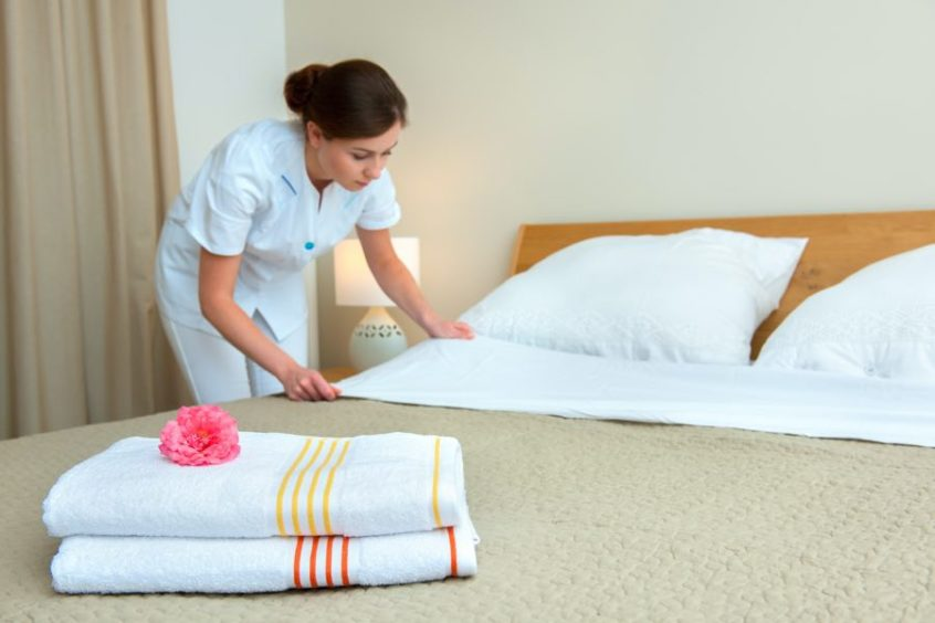 staff setting bed